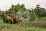 Photo excavator digging drains selfhelp