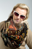 Photo studio portrait of beautiful middle age woman with scarf and sunglasses
