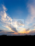 african sunset with dramatic clouds on sky kavango namibia