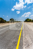 Fotografie endless road in namibia caprivi game park with blue sky