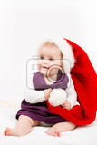 child girl with christmas santa hat on white background