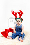 child girl with christmas santa hat and reindeer antlers on white background