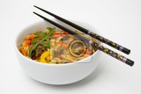 Fényképek Plate and bowl. China, food, chopsticks, vegetables, colors, and white background.
