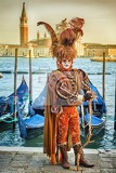 venice italy  february 27 2014 unidentified person with venetian carnival mask in venice italy on february 2014 in 2014 was the venetian carnival held between 15 february and 4 marchfor only editorial