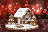 Fotografie homenade holiday gingerbread house with bokeh and snowflakes