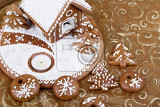 Fotografie homenade holiday gingerbread house on yellow christmass background