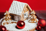 Fotografie holiday gingerbread house on red background christmas cookie