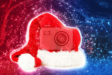 Fényképek red santa hat on red blue abstract background