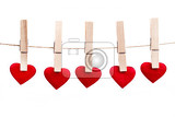 red fabric heart hanging on the clothesline isolated on white background love concept
