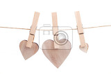 wooden heart hanging on the clothesline isolated on white background love concept