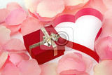 Fotografie rose petals heart and valentine present box background with space for text