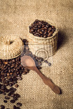 Fotografie pile of coffee beans and wooden spoon in jar with space for text