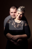 studio shoot of beautiful fashion xxl woman with her husband happy couple love concept