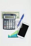 Photo usa dollar money banknotes and calculator money concept business workplace with mobile phone
