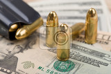 detail of bullet on us dollar banknotes crime or corruption concept