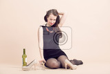 Photo studio portrait of a beautiful young brunette woman holding a glass of white wine