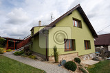repaired rural house fixed facade insulation and painted to green  color