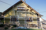 Fotografie construction or repair of the rural house fixing facade insulation and using color for new look
