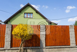 Photo repaired rural house fixed facade insulation and painted to green  color