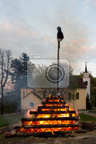 walpurgis night burning witch on wood and religion cross with huge flames