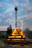 Photo walpurgis night burning witch on wood and religion cross with huge flames