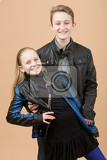 Fotografie fashion smiling european little long hair blonde girl and her brother posing in atelier