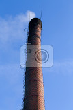 Fotografie polluting white smoke coming out of chimney against blue sky