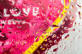 Fotografie color abstract love background with water drops on glass for background or backdrop