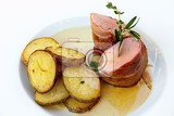 Photo roasted pork tenderloin with bacon roasted potatoes