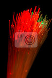 Photo bunch of optical fibres flying from deep as blurred abstract technology background