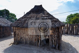 Fotografie traditional african village with housed and wooden fence in namibia near town kavango in region with the highest poverty level in namibia
