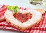 heart shaped  linzer cookie with jam filling