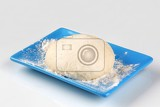 Fotografia raw pizza dough on a blue plate