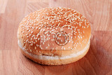 hamburger bun with sesame seeds on top