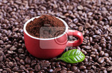 freshly ground coffee in a red cup