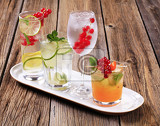 glasses of iced drinks garnished with fresh fruit