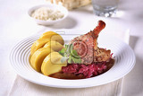 Fotografie roast duck legs with red cabbage and  potato dumplings