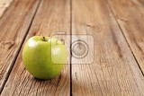 granny smith green apple on wooden table
