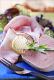 Photo detail of liver pate and thin slice of bacon