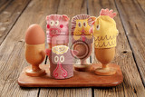 Fotografie funny animal egg cosies for boiled eggs