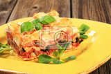 Fotografia portion of tasty lasagna on a plate
