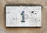 Photo block number on a weathered wall  detail