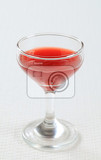 red juice in a wine glass