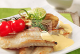 pan fried fish fillets and hollandaise sauce
