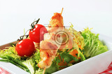 chicken skewers and mixed salad greens
