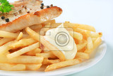 pan seared pork chop with french fries and mayonnaise