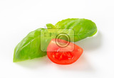 fresh tomato wedge and basil leaves