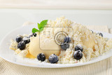 Fotografie blueberry dumplings with cottage cheese sugar and butter