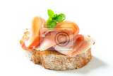 slice of bread with prosciutto