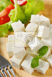 Fotografie cubes of feta cheese on a plate